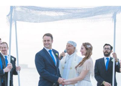 wedding service outdoors with rabbi